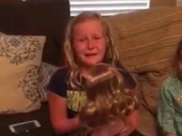Girl with artificial limb breaks down after getting doll with leg to match hers
