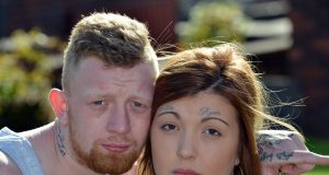 Man convinces girlfriend to get his name tattooed on her forehead