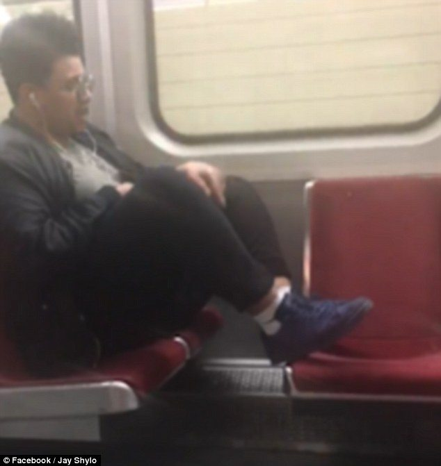 man taking too much space in public transportation