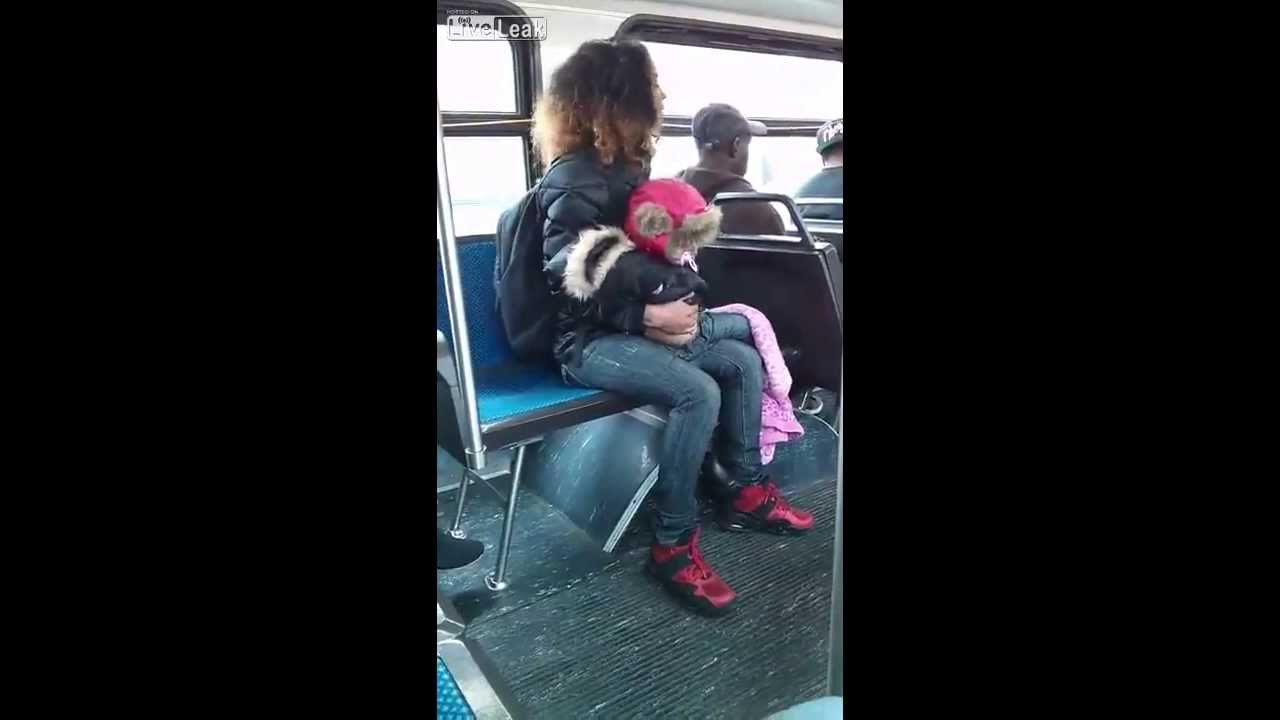 woman throws baby bus fight